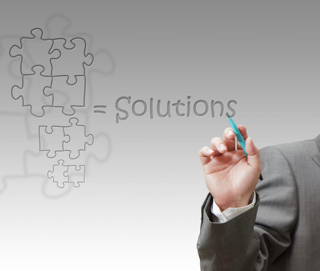 Businessman draws success puzzle